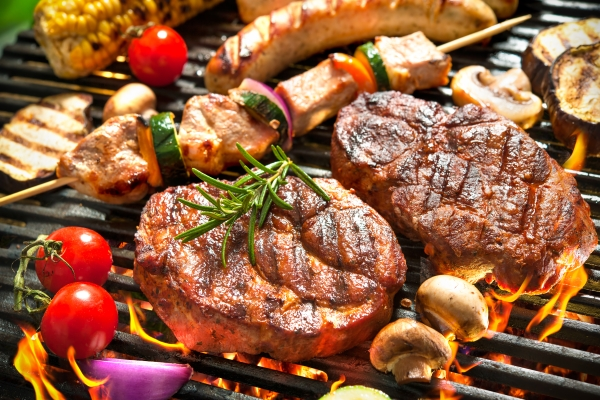 barbecue with vegetables and, burgers, meat, sausages and herbs