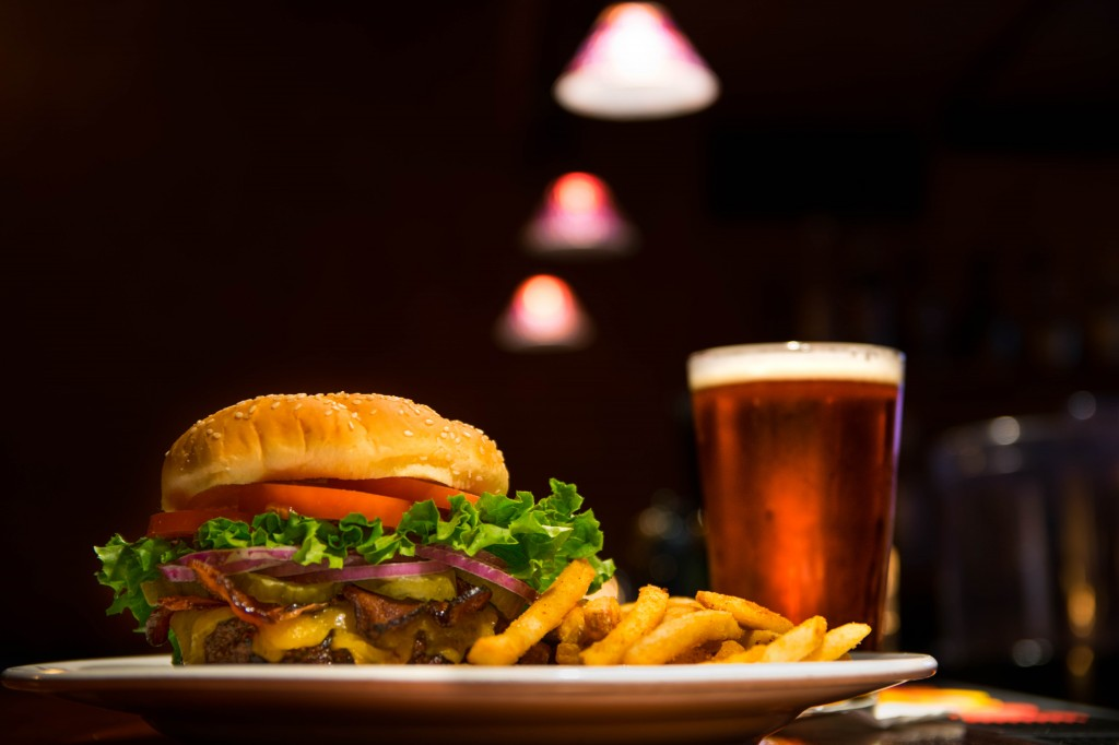 burger and chips with a pint in a pub