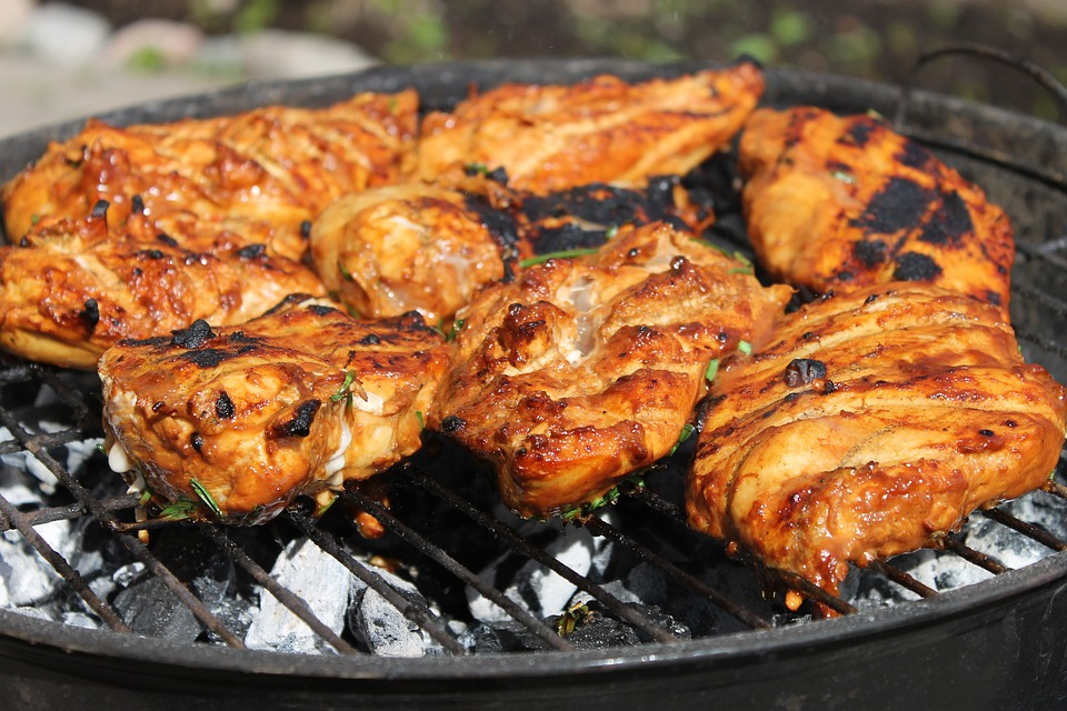 Barbecue Carnival chicken on a grill, who invented the bbq